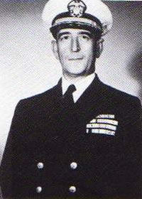 Captain Edward A. Solomons, USN Becomes Commanding Officer