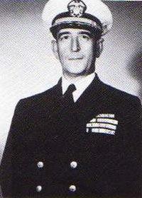 Captain Edward A. Solomons, USN Becomes Commanding Officer