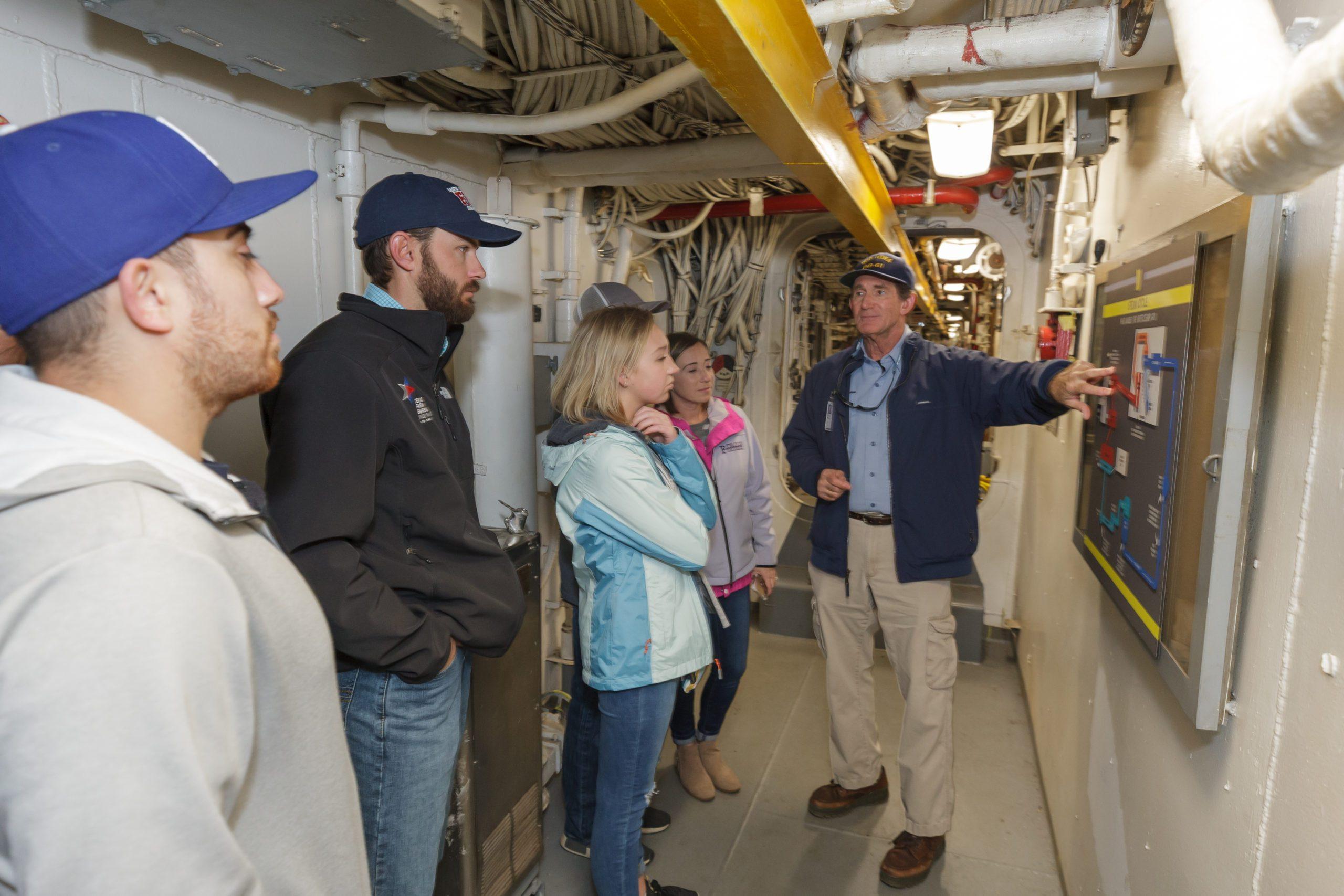 Battleship IOWA Full Steam Ahead tour takes visitors to the engine room.