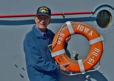 Veteran holding life ring